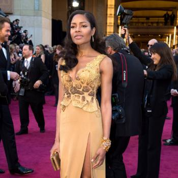 British actress and Bond Girl Naomie Harris wears a dress designed by SCAD Atlanta fashion student Michael Badger on the Oscar red carpet