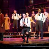 Performing arts students singing on stage Spring Awakening