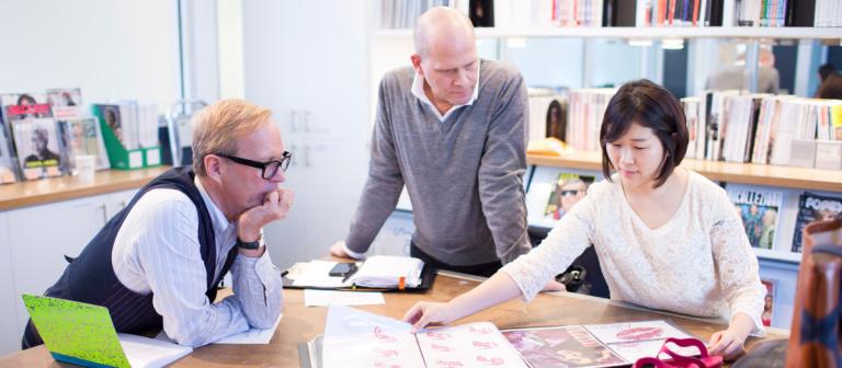 Accessory design mentors Lambertson Truex reviewing portfolio with student