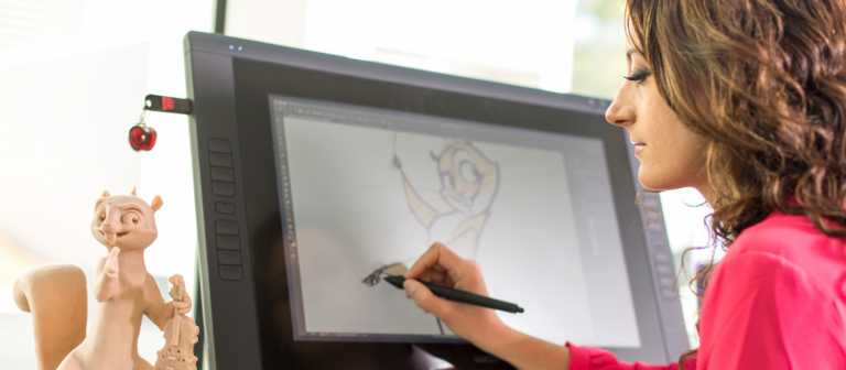 Animation student drawing on Cintiq in Montgomery Hall