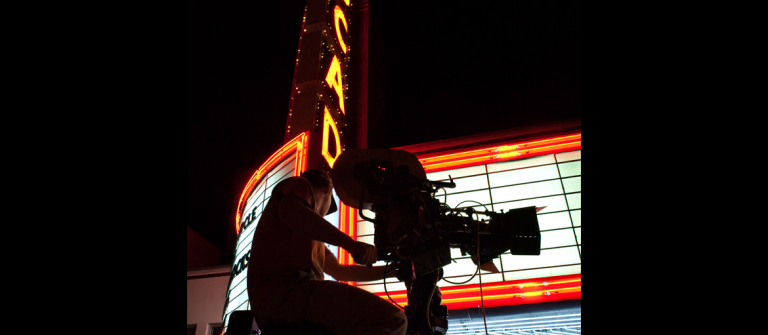 Television camera in front of marquee