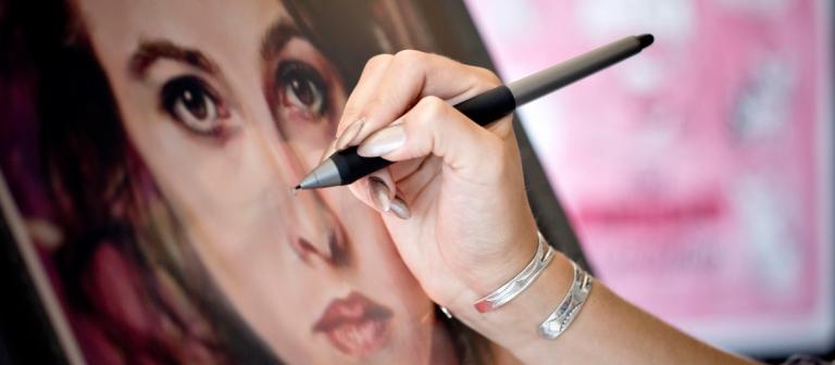 Illustration student creating digital portrait on Cintiq