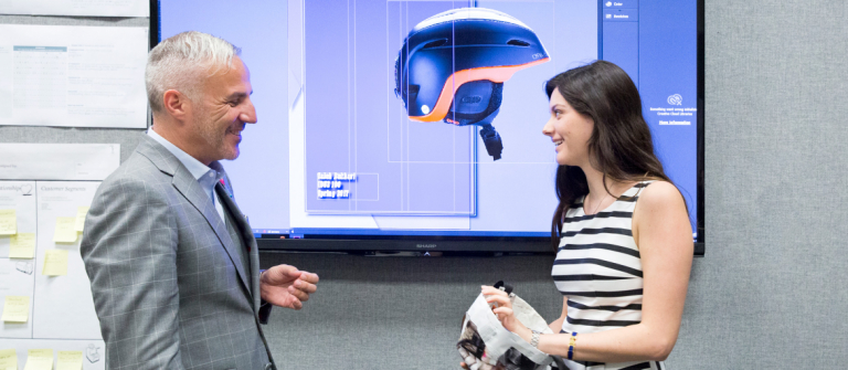 SCAD industrial design professor working with student