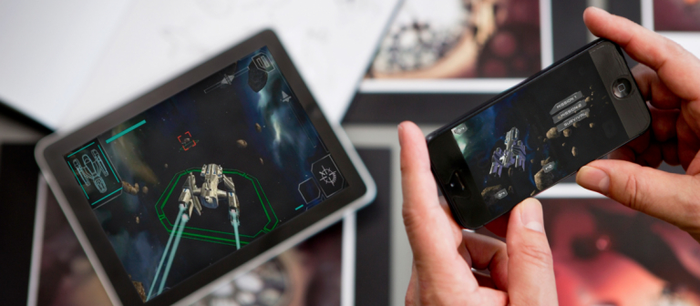 SCAD student gaming on mobile phone and tablet