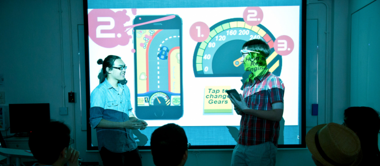 Interactive design and game development students giving demonstration