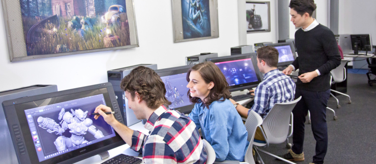 Students work in a digital lab at the Savannah location