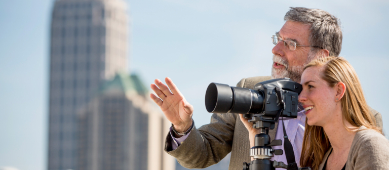 Photography student shooting with professor on SCAD Atlanta rooftop