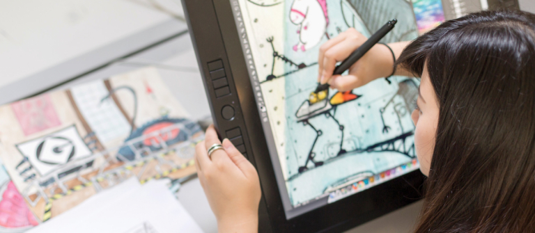 Themed entertainment design student drawing on Cintiq