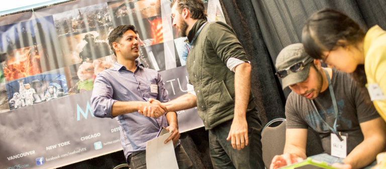 Student shaking hands with potential employer at Career Fair