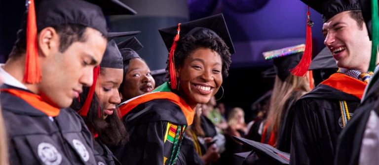 Smiling graduate at SCAD Savannah commencement