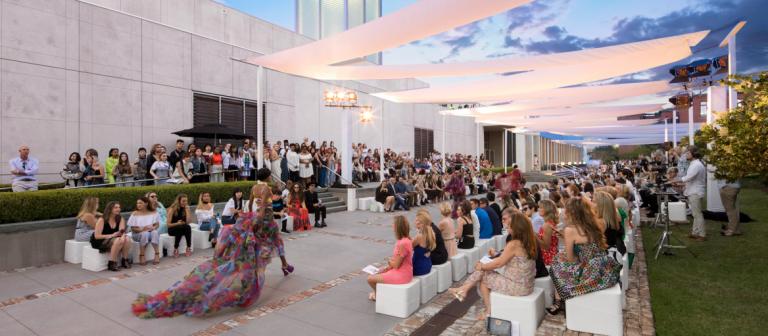 Model walking runway at Savannah fashion show at scad museum