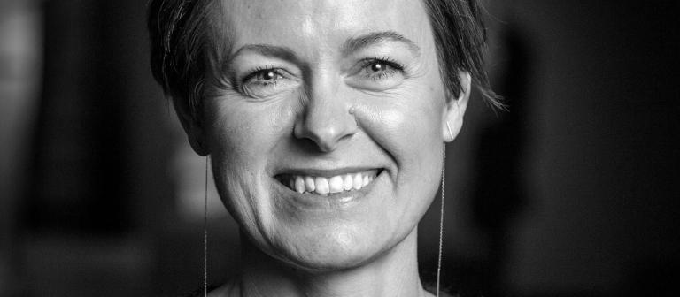 black and white portrait of Trine Sondergaard smiling