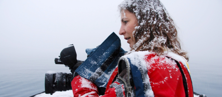 Janet Biggs in snow with camera
