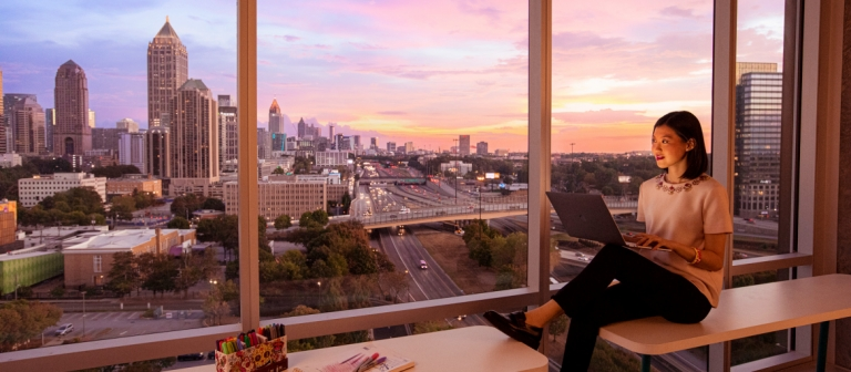 SCAD student studying with view of skyline