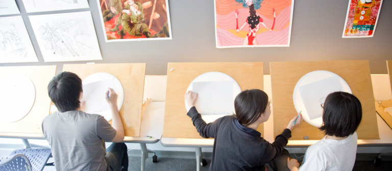 Animation students working at light tables
