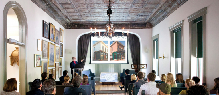 Preservation design student giving presentation in chapel of Clarence Thomas Center
