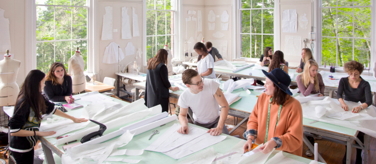SCAD fashion students working on patterns in Eckburg Hall