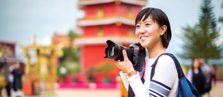 Hong Kong student exploring city with camera