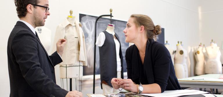 SCAD fashion senior reviewing work with William Calvert