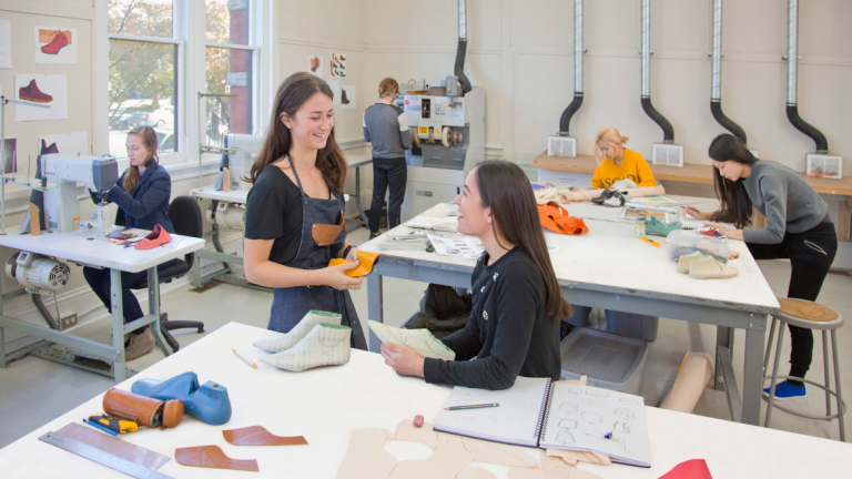 Accessory design students making shoes in Eckburg Hall