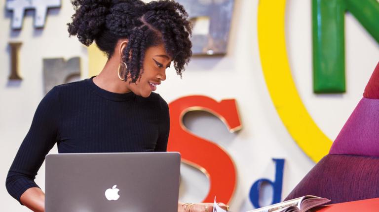 Atlanta advertising student at work on laptop