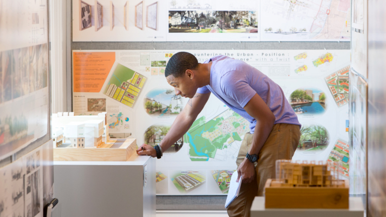 Architecture student viewing NAAB exhibit
