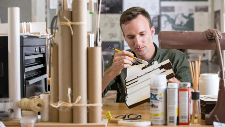Architecture student building model in Eichberg Hall studio