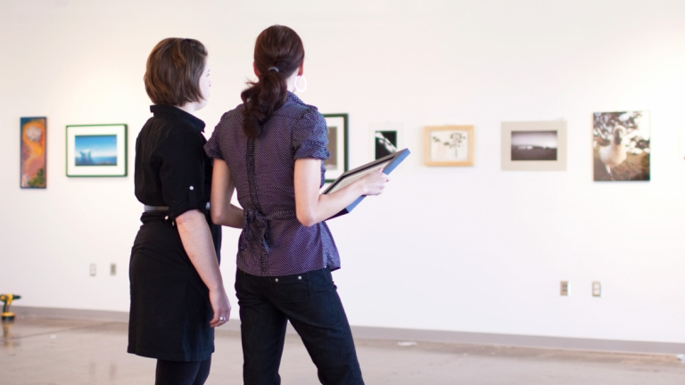 SCAD students intalling artwork for gallery exhibition