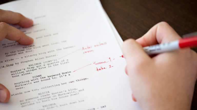 Dramatic writing student editing script