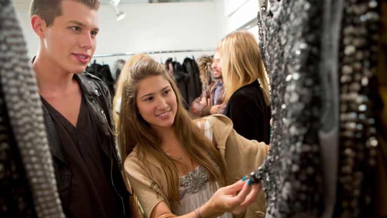 Fashion marketing and merchandising students viewing garments at AmericasMart