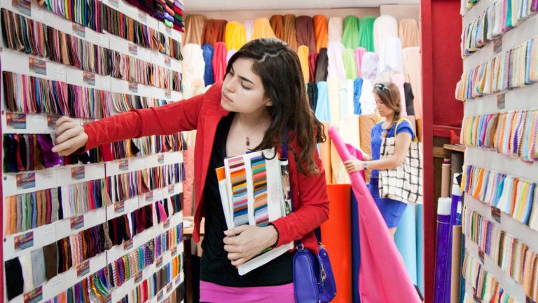 Hong Kong fashion student shopping at fabric market