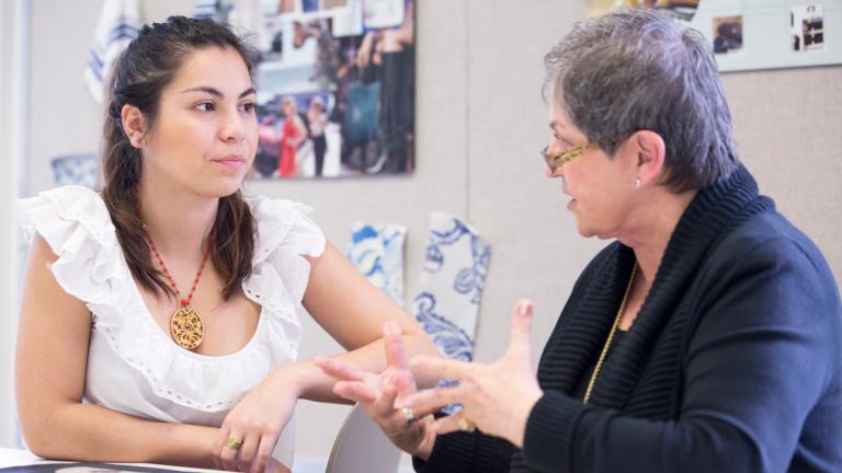 SCAD professor advising student