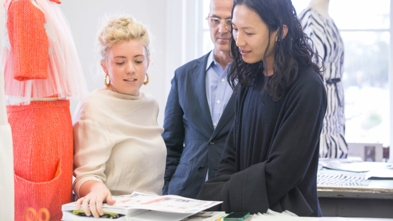 Steven Kolb and Alexander Wang reviewing fashion student work