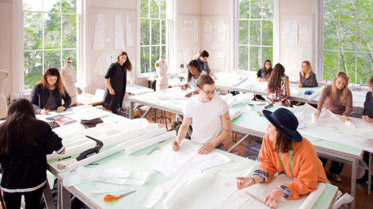 Students in the School of Fashion work collaboratively in Eichberg Hall