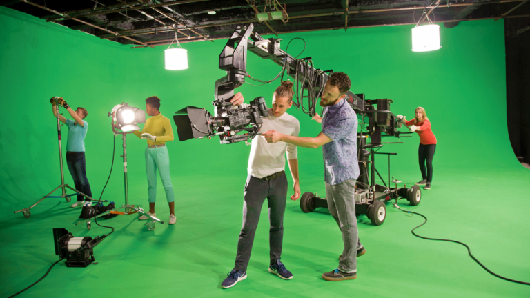 Film and television students working in green screen studio