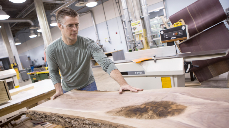 Furniture design student in woodworking studio at Gulfstream Center for Design