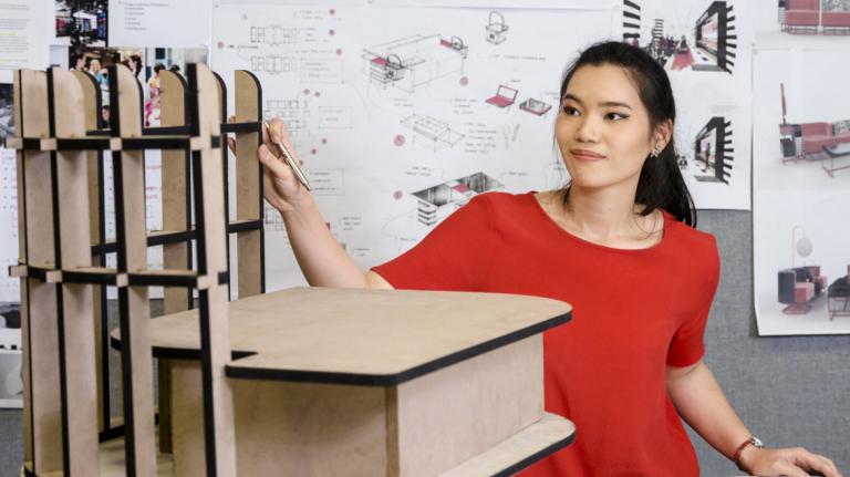 Furniture design student works on project