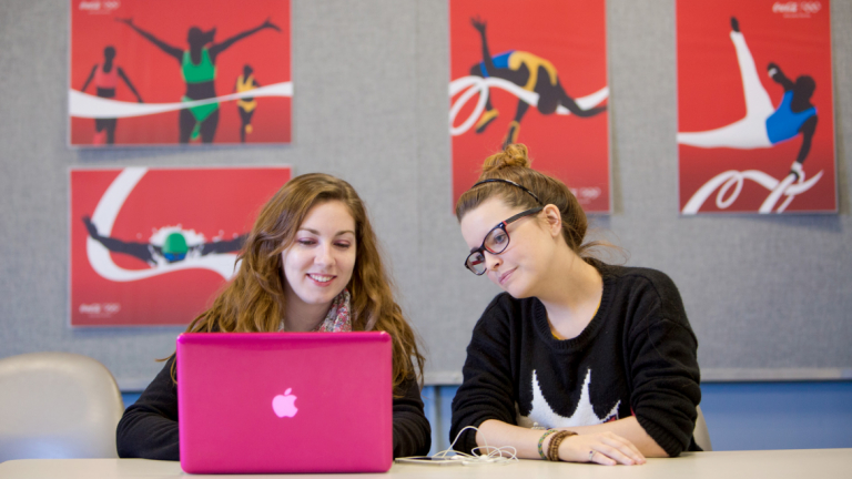SCAD students using laptop to collaborate on project