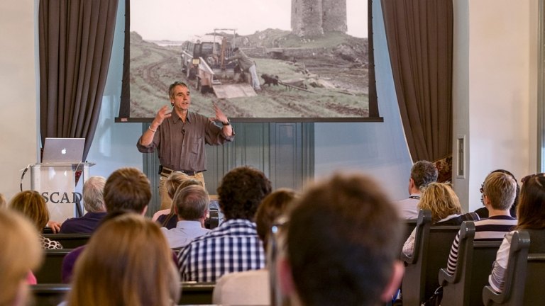 Actor Jeremy Irons lecturing on preservation design in the Clarence Thomas Center chapel