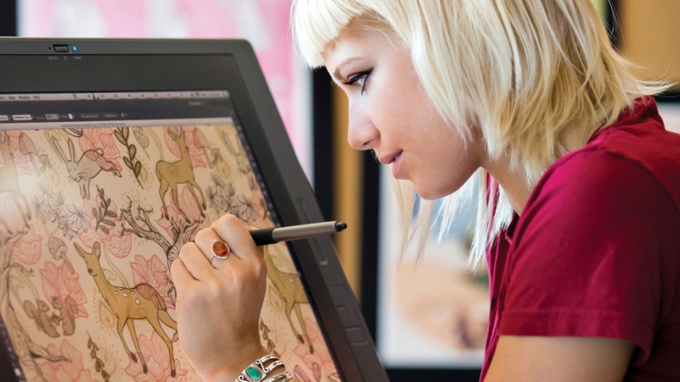 Illustration student using Cintiq to create digital artwork