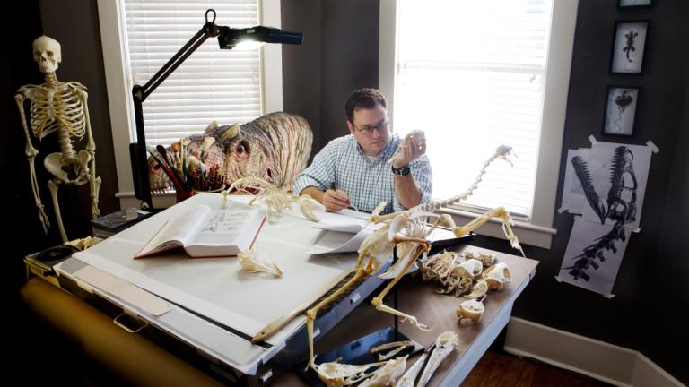 Scientific illustration student sketching a specimen in studio