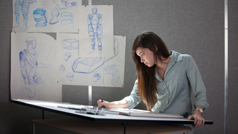 Industrial design student sketching in studio