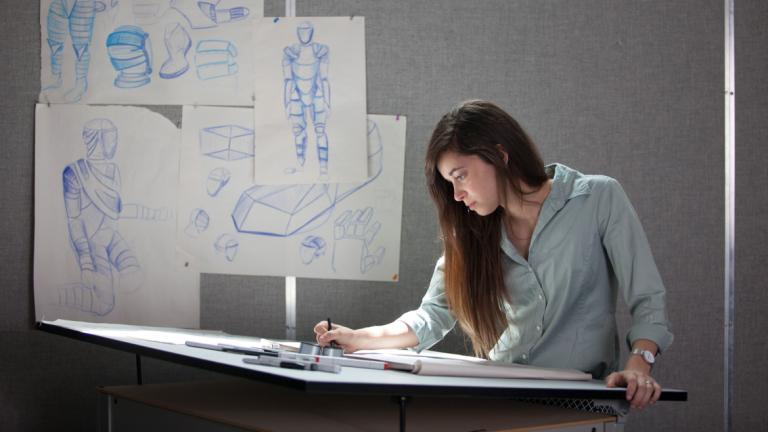 Industrial design student sketching in studio