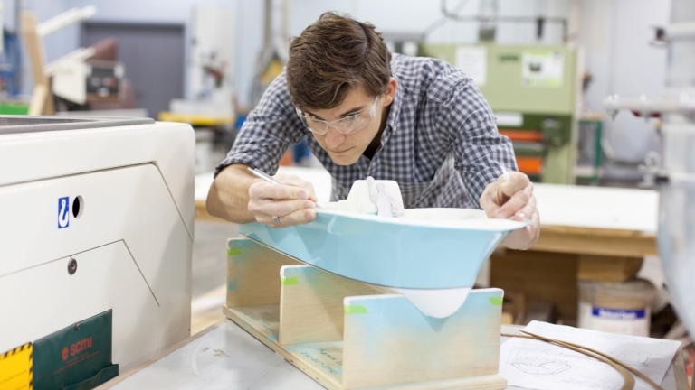Industrial design student working on boat model at the Gulfstream Center for Design
