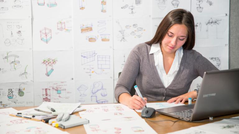 Industrial design student sketching designs in studio