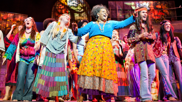 Performing arts students singing in production of Hair