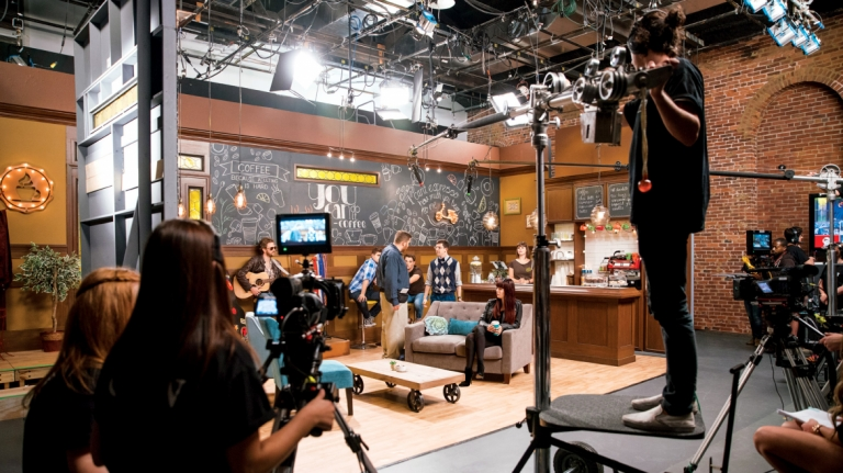 Performing arts students filming episode of The Buzz