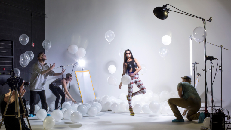 SCAD students working on set of fashion photo shoot
