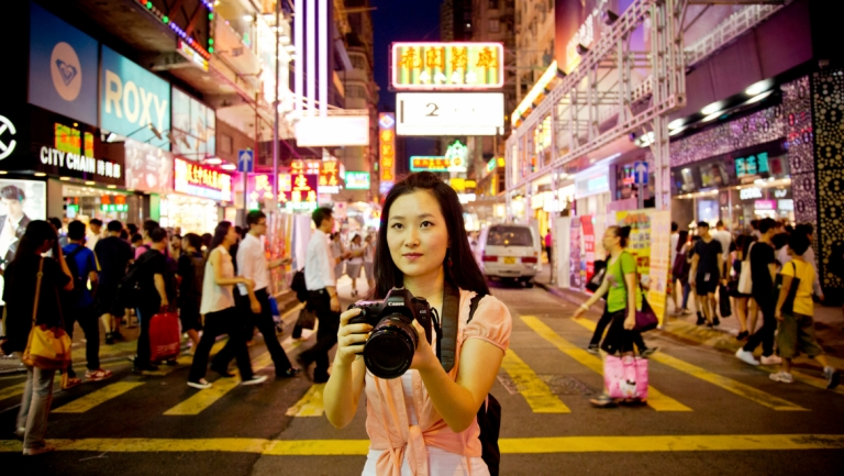 Photography student shooting in street of Hong Kong