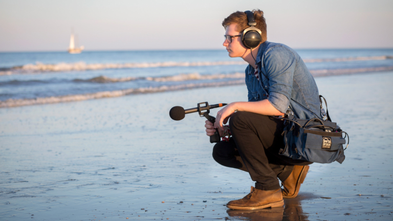 SCAD student using field recording equipment to capture beach sounds
